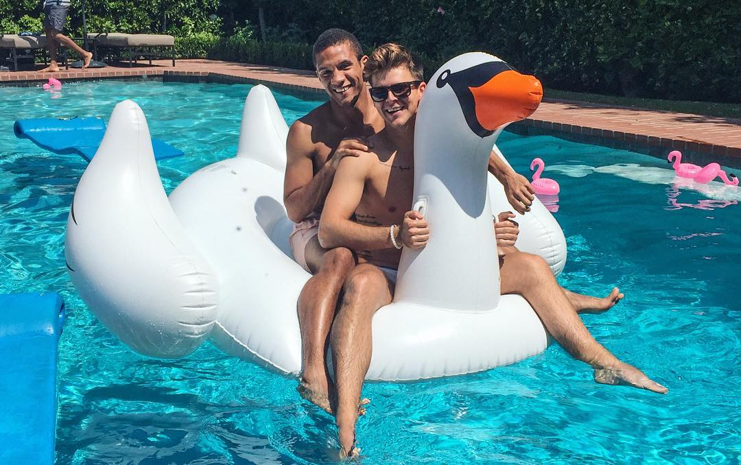 boys-are-swanning-in-the-summer-pool